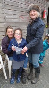 Edith Receiving Grade 1 Proficiency Award in Riding and Horsecare from Instructor Mary Allbrook