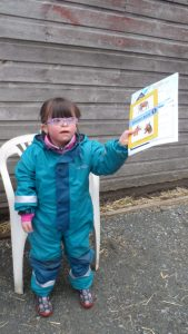 Eva displaying her Grade 1 award in Riding and Horsecare