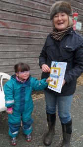 Eva receiving her Grade 1 Riding and Horse Care from instructor Mary Allbrook